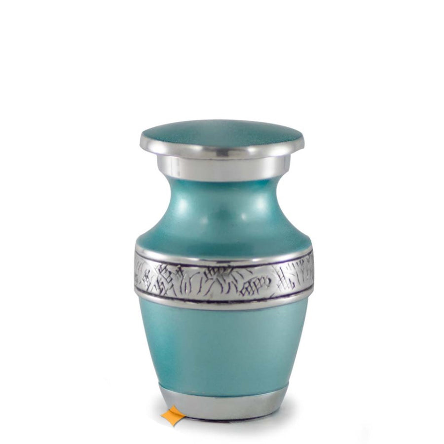 Cremation Urn with Beautiful Turquoise Finish and Hand-Tooled Antiqued Pewter Band. Threaded lid allows secure closure. Felt-lined base.