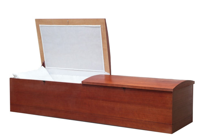 Simple Cremation casket made of walnut wood veneer, and lined in white satin.