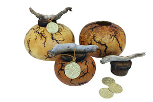 Our gourd cremation urns are grown and crafted in the U.S. desert-southwest and a include bronze memorial pendant that hangs from ornamental drift-wood.