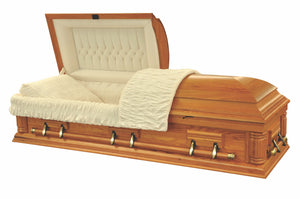 Oak casket in solid wood polished to a matte finish, and lined in plush beige velvet.