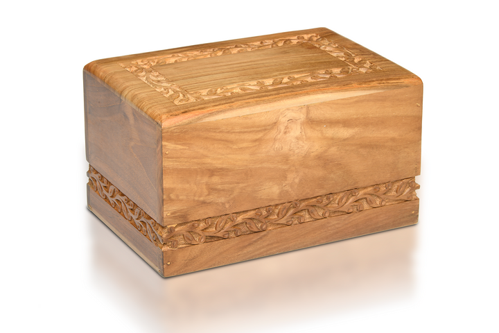 Our teak wood urns with hand-carved border design are simple yet elegant.