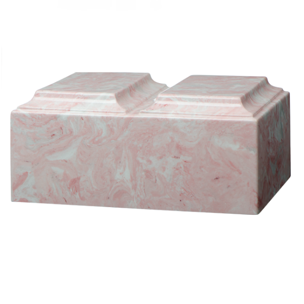 Companion cremation urn in pink, made from solid cultured marble. Dimensions 13.25? L x 9.5? W x 6.5? H, Capacity 450 cu. In. Weight 24 lbs.