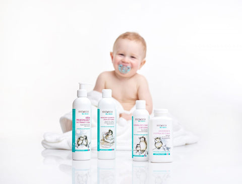 Baby sitting with Sylveco for Baby skincare cosmetics