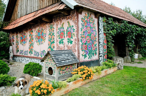 barn and dog house painted with floral motives