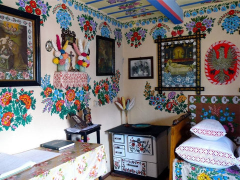 indoors of the house painted in colorful floral motives