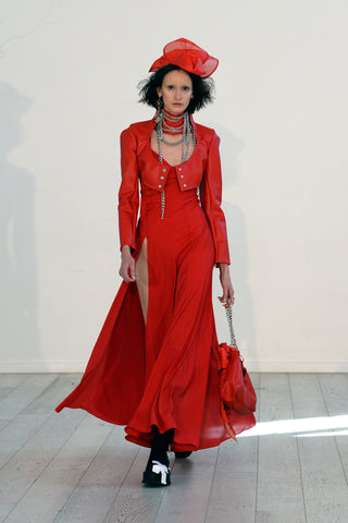 Lula Laora ss22 the garden Getty runway, long red dress with two high slits, red leather jacket, red hat.