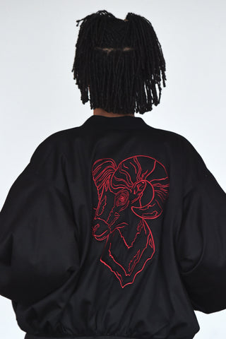 LULA LAORA AW21 Getty Images, womenswear model wears a black bomber jacket, the back has an embroidered ram.