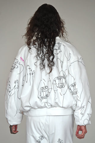 LULA LAORA AW21 Getty Images, the back of menswear model wears a white bomber jacket with black illustrations and white large joggers/sweatpants.