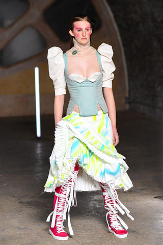 Lula Laora runway Getty, fuchsia high top sneakers, neon tourterelle skirt with ruffles, vintage inspired top with puffy short sleeves in aqua