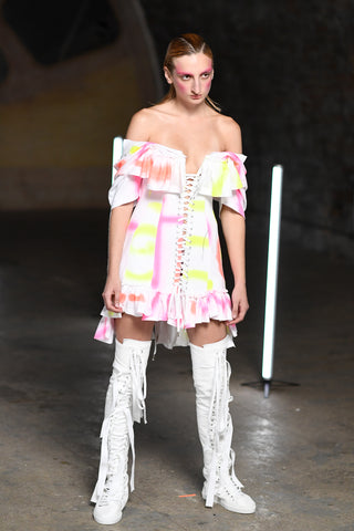 Lula Laora runway Getty, neon and white dress with high top sneakers white