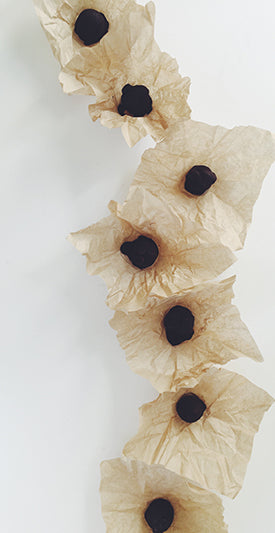 Hnina Raw dark Chocolate Pebbles Wrapped in Compostable Kraft Paper