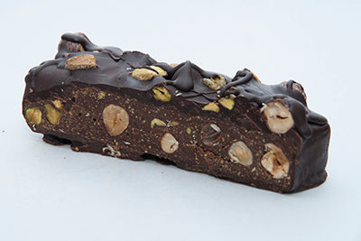 healthy Gourmet Raw Dark Chocolate brick with sprouted hazelnuts and sprouted pistachios cross cut