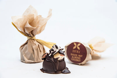 Hnina sprouted truffles are made with organic raw dark chocolate and sprouted nuts while being enclosed into a compostable packaging.