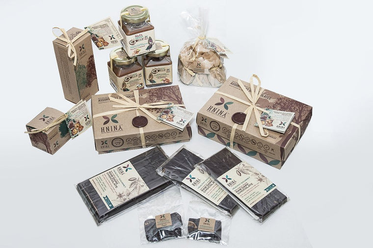 HNINA Organic Fairtrade Raw Dark Chocolate specialties are Free of sugar, emulsifier, dairy, preservatives include our pure raw dark chocolate tablets, assorted boxes, boulder and a brick of our pure raw dark chocolate truffles made with sprouted nuts or sprouted seeds and Nuts About Chocolate spreads. This can stop your sugar cravings by nourishing you with real nutrients dense foods. Get your body nourished with pure gourmet divine treats.