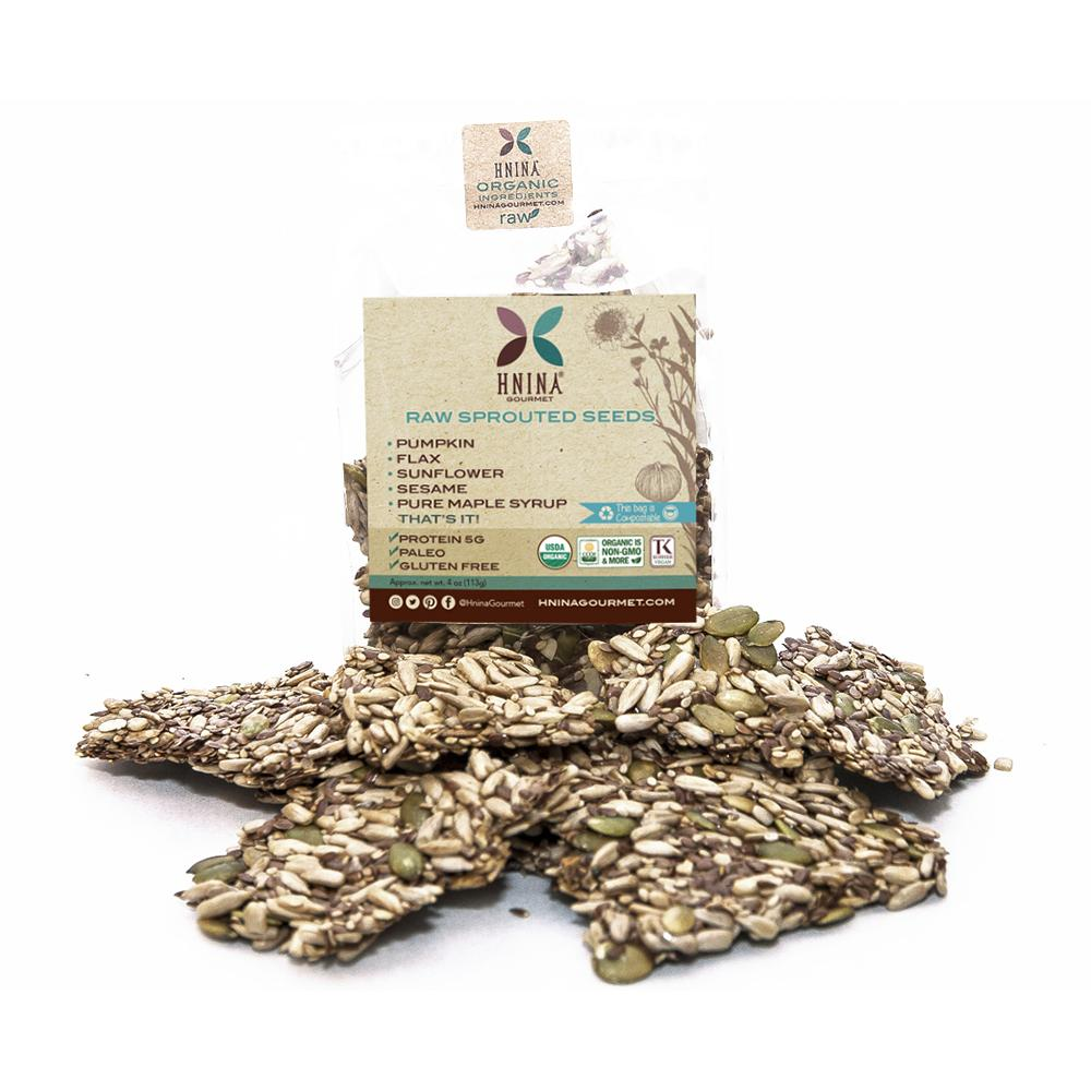 Hnina Raw Sprouted Seeds Cracker Snacks are composed of activated raw sesame, activated raw flax, activated raw sunflower and activated raw  pumpkin seeds covered with a little bit of pure maple syrup, like a sugar free and grain free granola cracker. They are satiating, nourishing and delicious raw cracker seeds snacks.