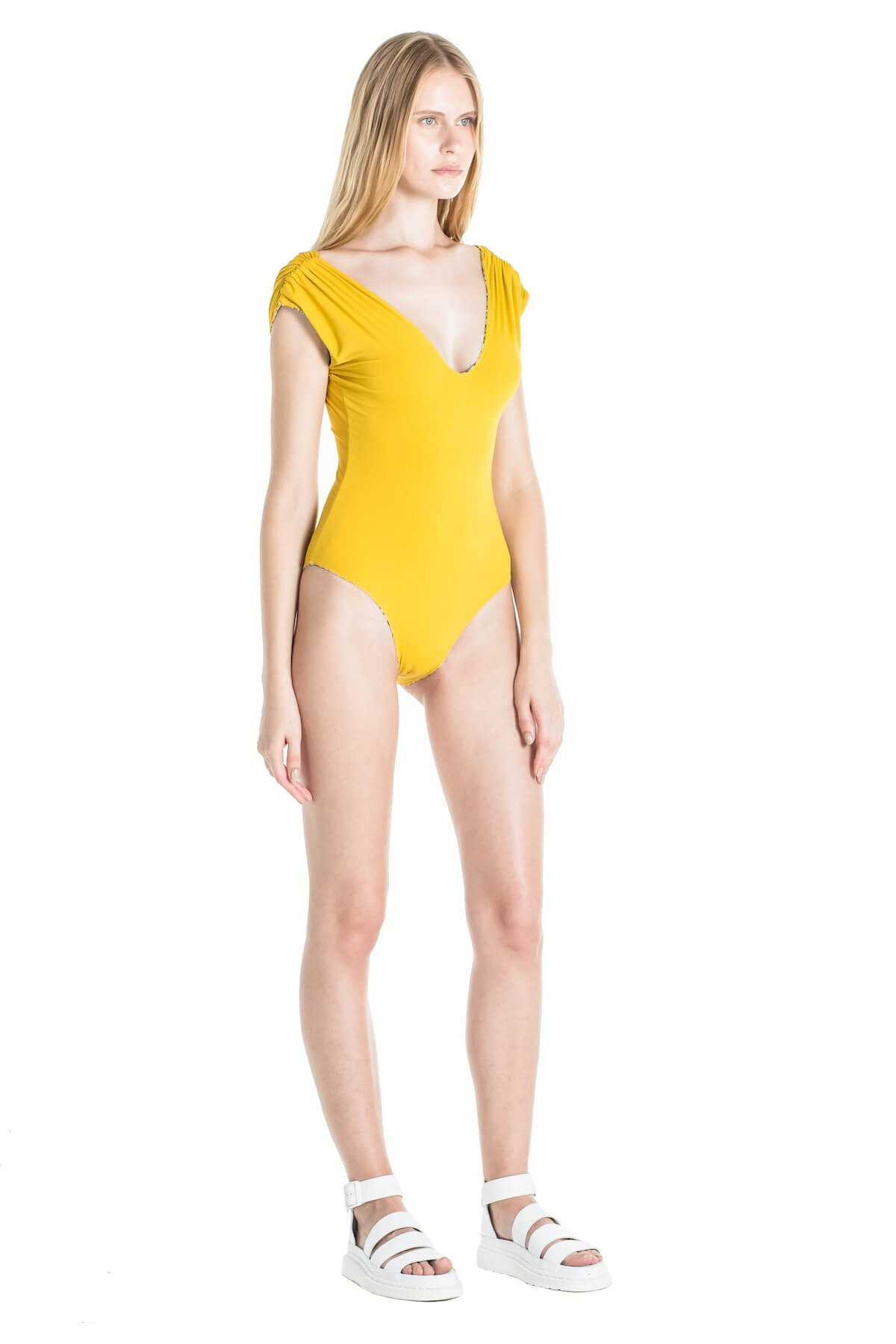 Side of Andrea one piece swimsuit in Mustard.