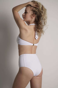 Model wears the Bianca white high waisted bottom. The back of the suit is shown.