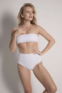 Model wears the Bianca white high waisted bikini bottom and the Bianca top without straps.