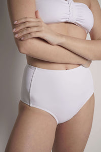 The high waisted bikini bottom, Bianca, shown on a model in this detail front image.