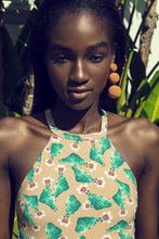 Model shows the top detail of the Denise cactus swimsuit.