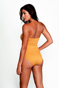 Back image of model wearing the Hannah One Piece Swimsuit in Ribbed Gold.
