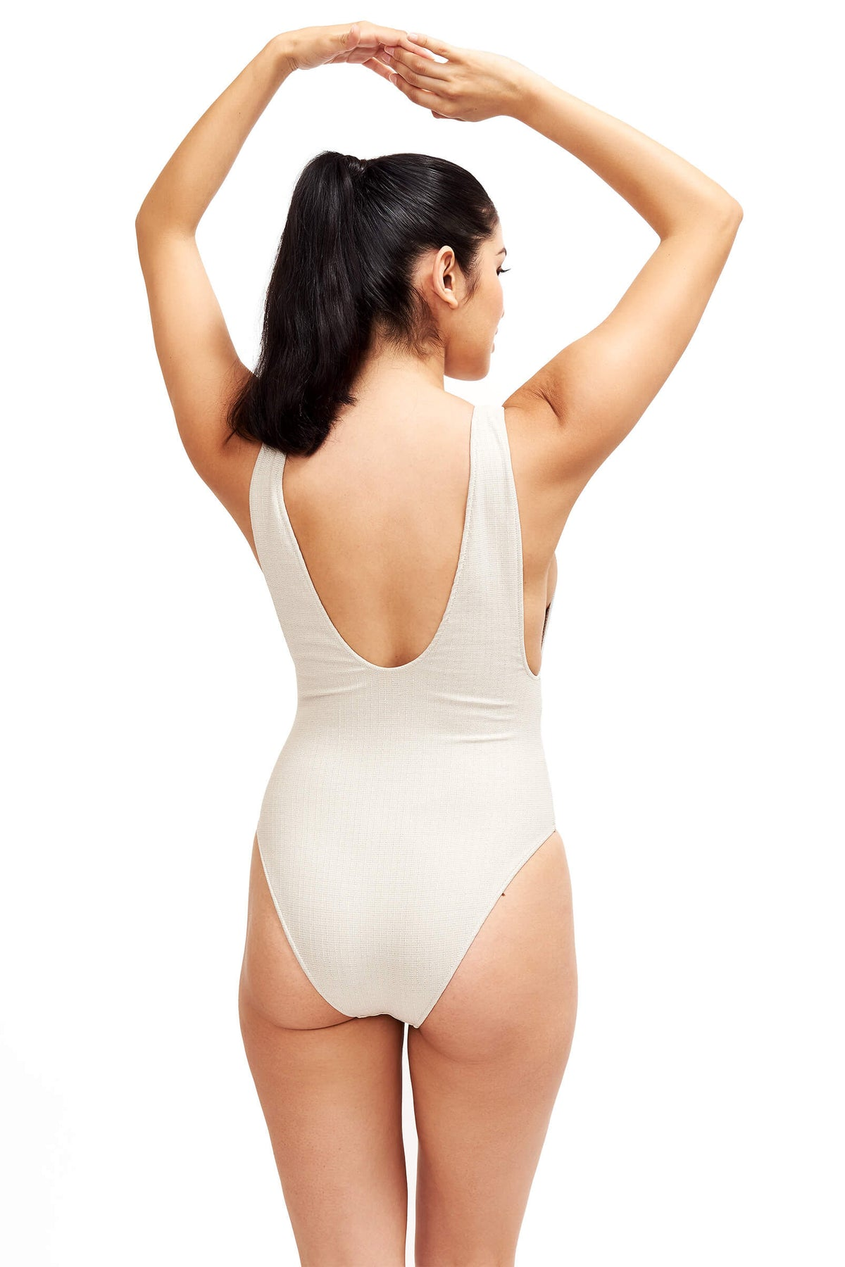 Model shows the back of the Helena Swimsuit in Platinum