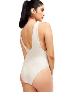 Another back image of model wearing the Helena swimsuit showing the side.