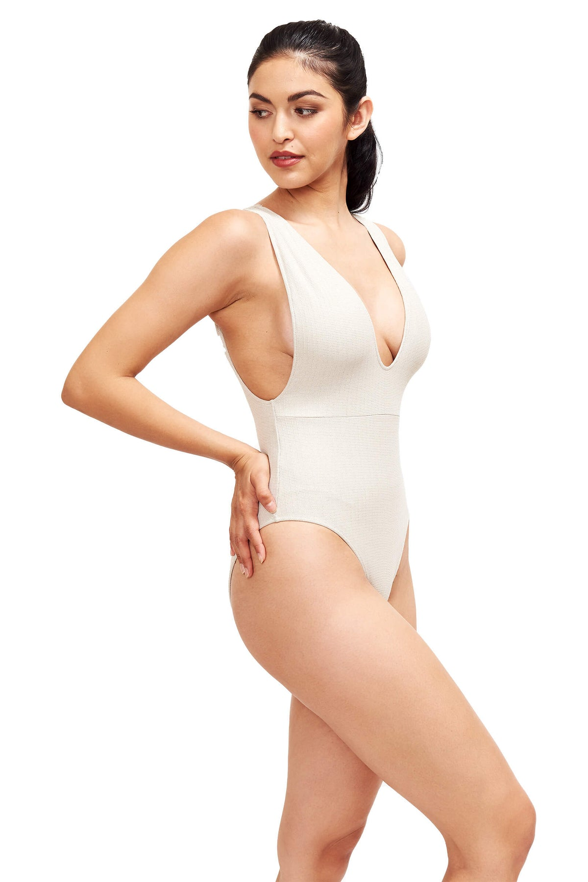 Model shows the side of Helena Swimsuit.