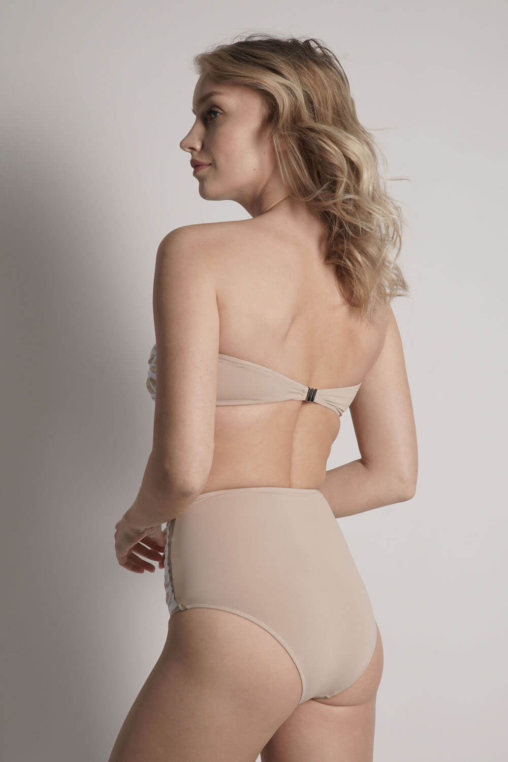 Back of Lillian high waisted bikini bottom in camel with white laser details