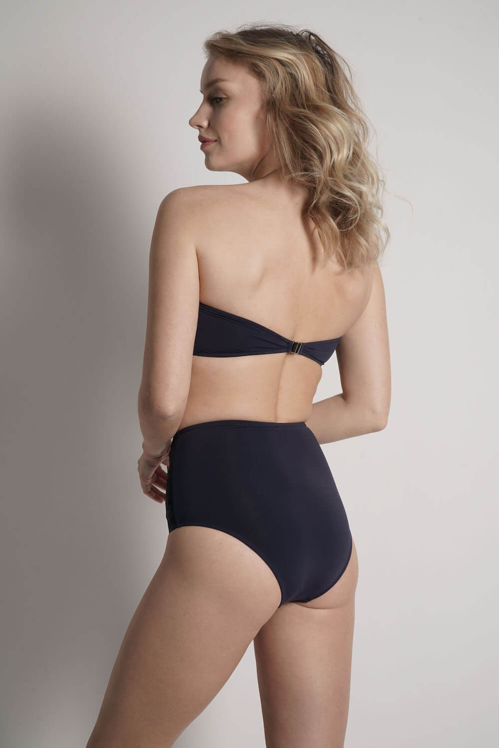 Back image of Lillian bandeau bikini top in navy with black laser details
