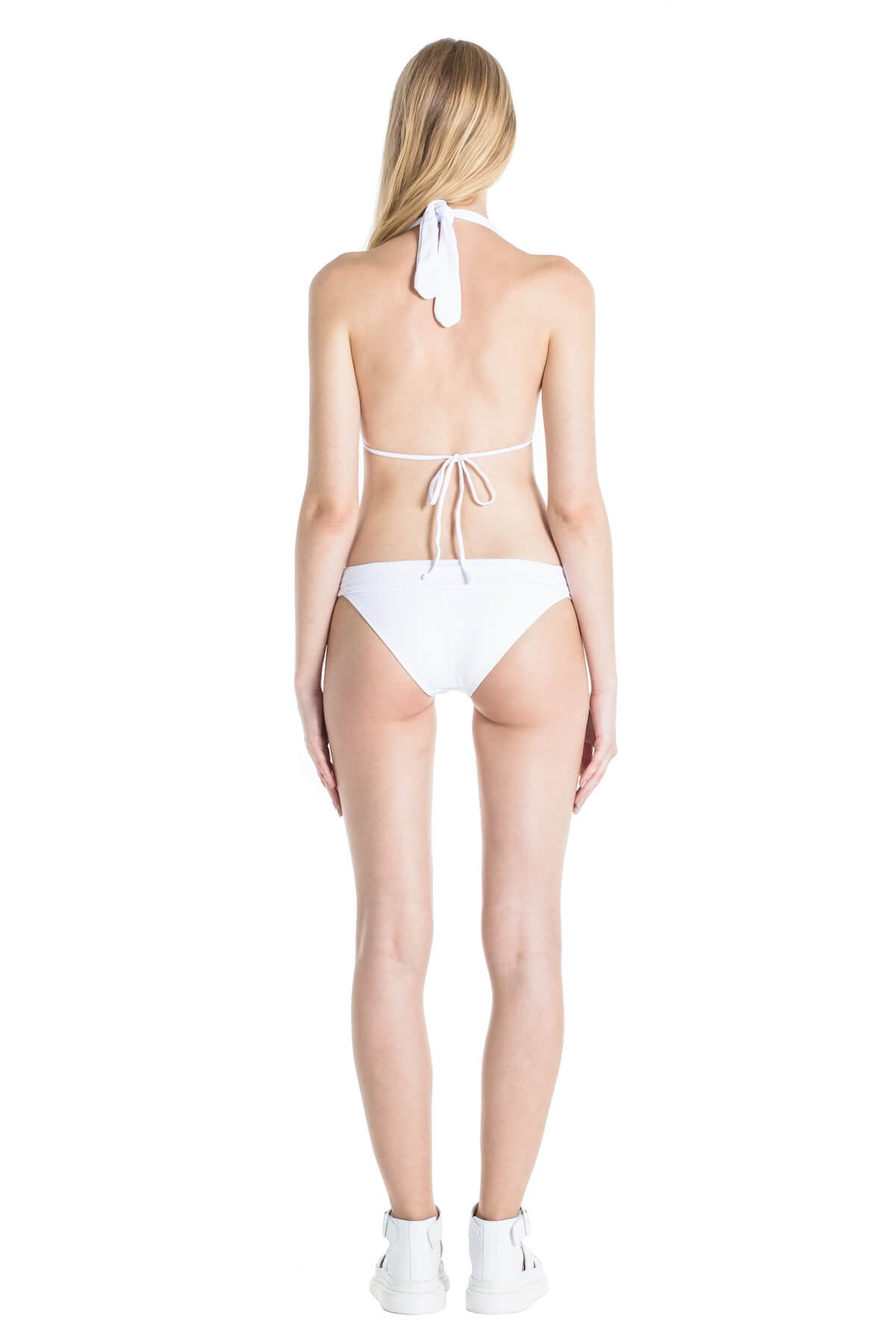 Image of the back of model wearing the Nina white bathing suit.