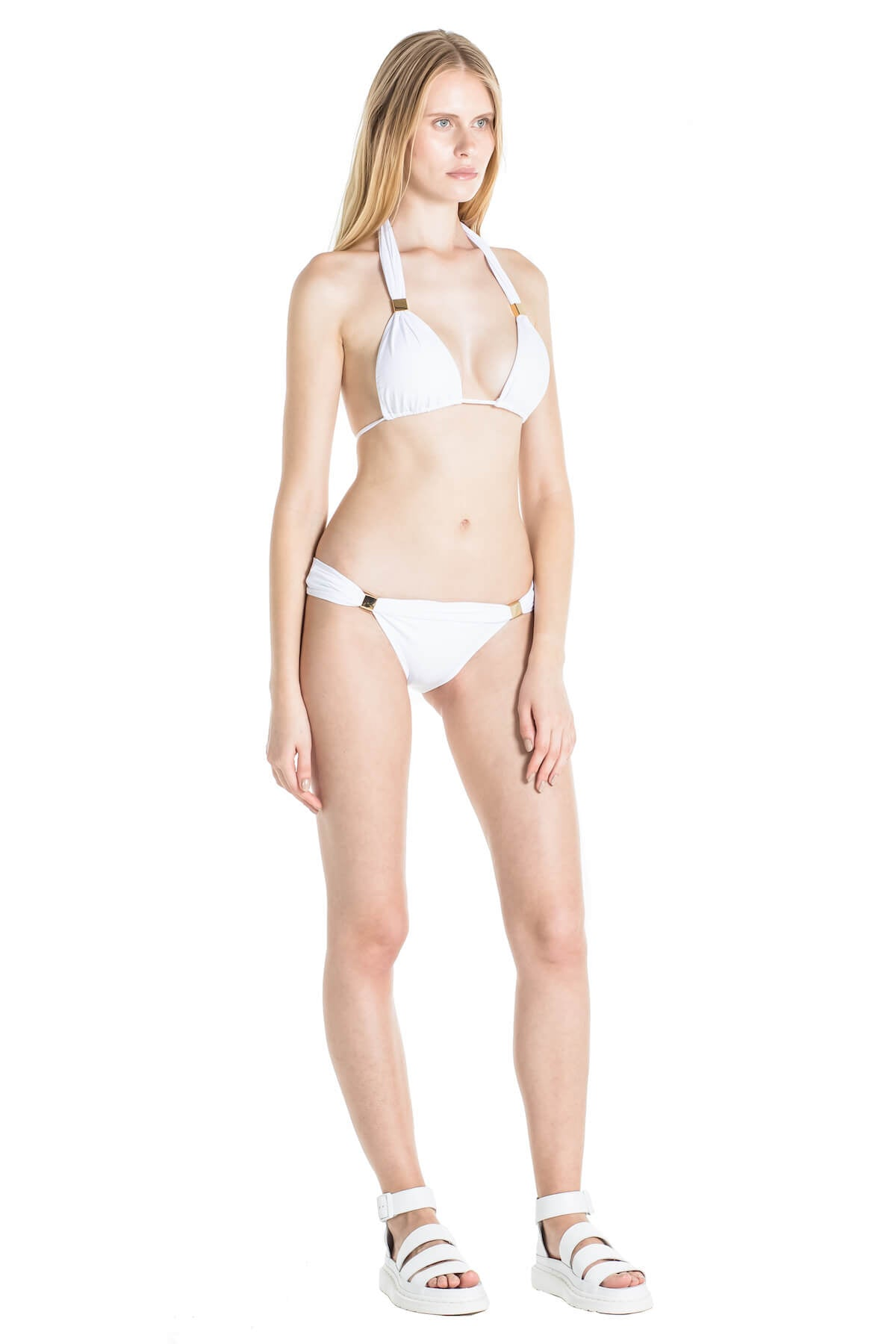 Model shows the side of the Nina white bathing suit.