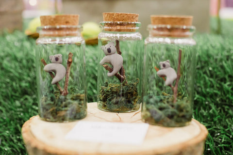 Tiny Koalas in Glass Bottles