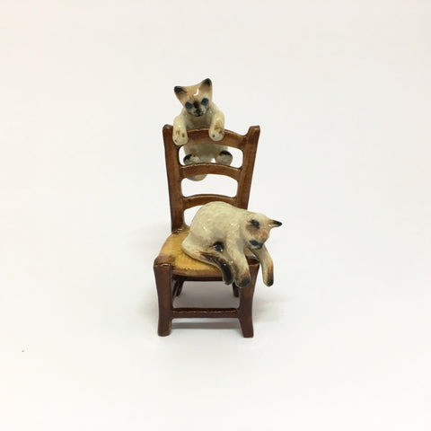 Small Miniature Ceramic Cats on a Chair