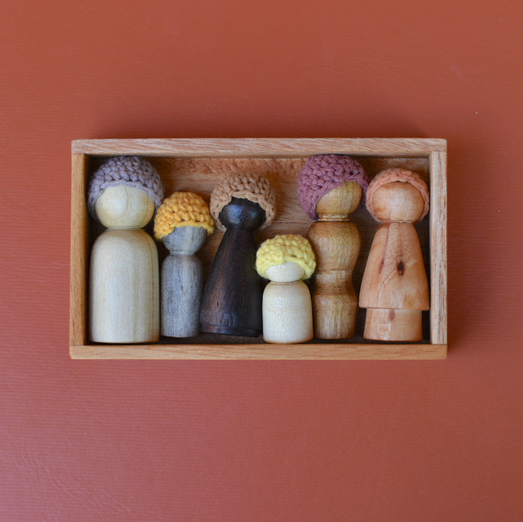 wooden peg dolls in a box