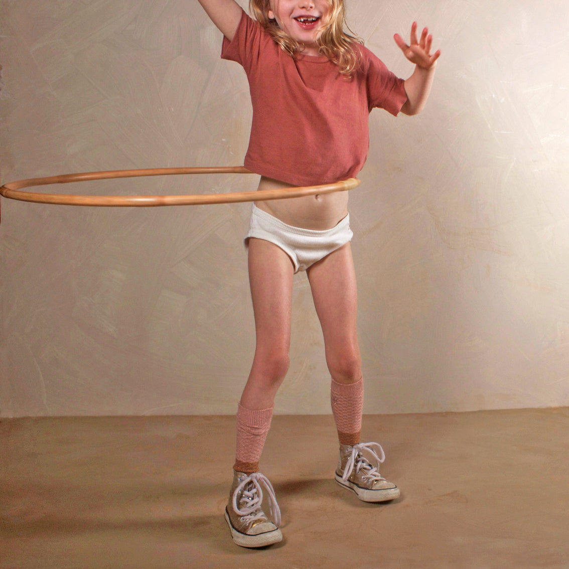 wooden hula hoop and child