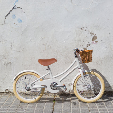 banwood pedal bike against wall