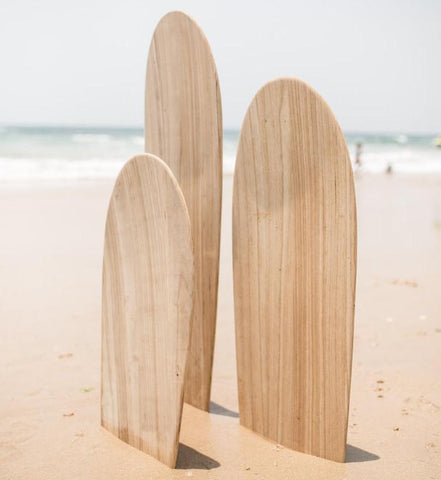 wooden boogie boards on beach