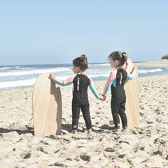 two toddlers and wooden boogie boards