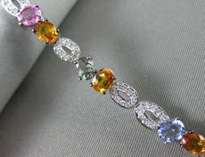 ESTATE .65CT DIAMOND & MULTI GEM 14KT WHITE GOLD 3D MULTI SHAPE TENNIS BRACELET