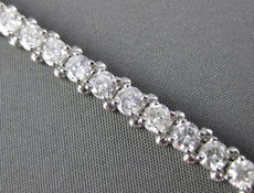 ESTATE WIDE 5.47CT DIAMOND 14KT WHITE GOLD CLASSIC FOUR PRONG TENNIS BRACELET