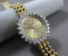 ESTATE .72CT DIAMOND 18KT WHITE & YELLOW GOLD CLASSIC ROUND GENEVE WATCH #7472