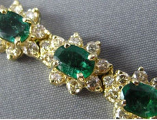 ESTATE WIDE LONG 23CT DIAMOND & EMERALD 14KT YELLOW GOLD FLOWER TENNIS BRACELET