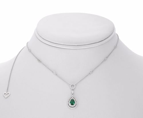 ESTATE .80CT DIAMOND & AAA COLOMBIAN EMERALD 18KT WHITE GOLD DOUBLE HALO PENDANT