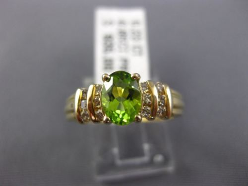 ESTATE 1.08CT ROUND DIAMOND & AAA OVAL PERIDOT 14KT YELLOW GOLD ENGAGEMENT RING