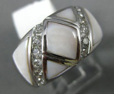 ESTATE LARGE .57CT ROUND DIAMOND & MOTHER OF PEARL 14KT WHITE GOLD CHANNEL RING