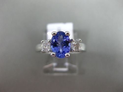 1.63CT ROUND DIAMOND & AAA OVAL TANZANITE 14K WHITE GOLD 3 STONE ENGAGEMENT RING