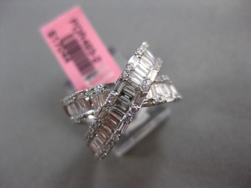ESTATE 1.12CT ROUND & BAGUETTE DIAMOND 18KT WHITE GOLD CRISS CROSS INFINITY RING