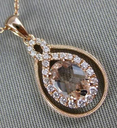 .77CT DIAMOND & AAA OVAL MORGANITE 14KT ROSE GOLD 3D INFINITY TEAR DROP PENDANT