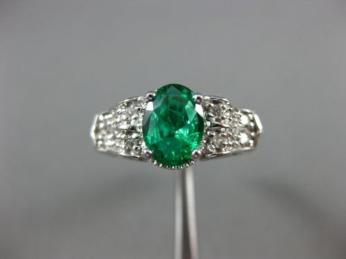 ESTATE 1.21CT DIAMOND & AAA OVAL EMERALD 14KT WHITE GOLD 3D LOVE ENGAGEMENT RING